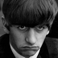 Ringo Starr with a sad expression on his face in black & white.